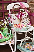 Vintage-style chair with cushions and Easter decorations