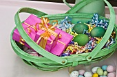 Easter nest with wrapped presents in dyed wicker basket