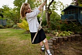 Girl playing with a rope in garden