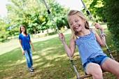 Girl on swing in garden