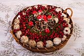 Basket of snail shells, berries and fly agaric ornaments