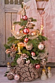 Little Christmas tree with romantic decorations