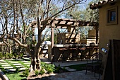 Tuscan backyard patio with grill and bar
