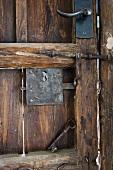 Skeleton key resting on old wooden door
