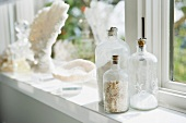 Detail decorative bottles on window sill