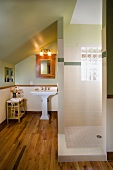 Bathroom with large walk in shower and glass block window