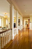 Traditional hallway in home with red oak hardwood floors