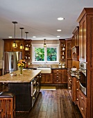 Hardwood floors and cabinets in kitchen