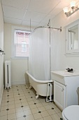 Traditional bathroom with claw foot tub