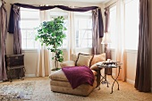 A reclining armchair in a bay window