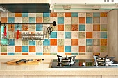 A kitchen with colourful ceramic tiles