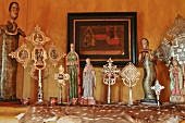 Decorative figurines and crosses on mantle