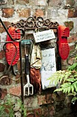 Garden tools and shoes hanging in the courtyard