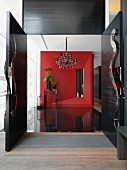 Modern entrance foyer with red wall