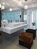 Modern bathroom with double sinks and ottomans