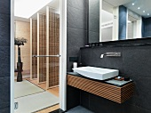 Slate tile walls in modern bathroom