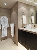 Bathrobe hanging in modern bathroom