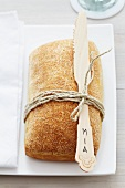 Bread roll and bamboo knife used as name card