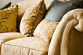 Floral cushions on traditional upholstered sofa