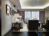 Elegant interior with classic, upholstered suite and modern, indirect lighting