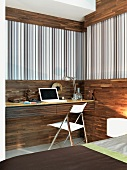 Office corner - fitted desk against half-height wood panelling and striped wallpaper below wooden frieze
