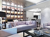 Classic sofa set and backlit fitted shelving in open-plan interior