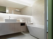 Washstand and base cabinet below floating mirrored panel with indirect lighting