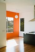 Modern Kitchen and Nook with Orange Wall