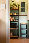 Vignette of kitchen wall unit and stool.