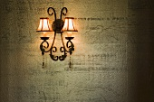 Wrought Iron Lamp on Gold Textured Wall