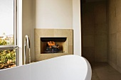 Stand Alone Bathtub in Front of Fireplace