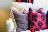 White Sofa with Red Decorative Pillows