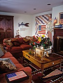 Cosy, American living room with playful USA imagery and bouquet of summer flowers