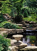 Glorious gardens with waterfall, pond and large stone goblet