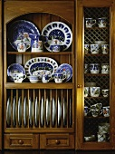 China collection in antique kitchen dresser