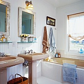 Sunny bathroom with two pedestal washstands