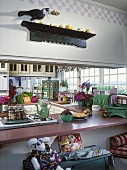 Country house kitchen with vast kitchen counters and long wall of windows