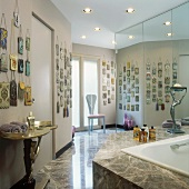 Large collection of handbags in modern bathroom with floor-to-ceiling mirrored cupboards