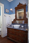Antique washstand with marble counter and integrated mirror
