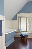 Tranquil, spartan bathroom in pastel blue and white