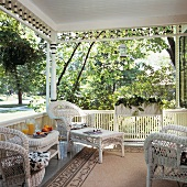 Summery terrace in the country with white recamier and rug