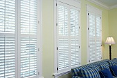 White wall of windows with Venetian blinds