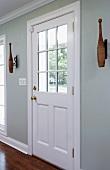 White front door with window element