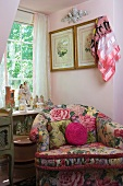 Comfortable armchair with striking floral design below window