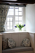 Traditional window niche with integrated window seat and cushions