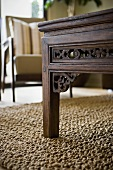 Detail ornately carved wood table