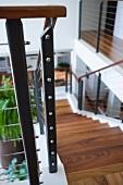 Contemporary Wooden staircase with wire railing