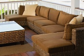 Wicker couch in an outdoor sitting area