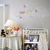 Nursery with hand-painted wall