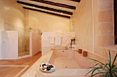 Large bathroom with ceiling beams and tile floor